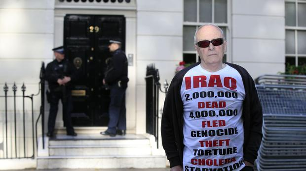 Protester Michael Culver, 78, stands outside the London home of former prime minister Tony Blair ahead of the publication of the Chilcot report