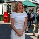 Singer Ellie Goulding arrives at Wimbledon yesterday
