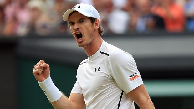 Andy Murray reacts during his match against Jo-Wilfried Tsonga at Wimbledon