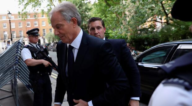 Tony Blair arrives back at his home in the wake of the publication of the Iraq Report
