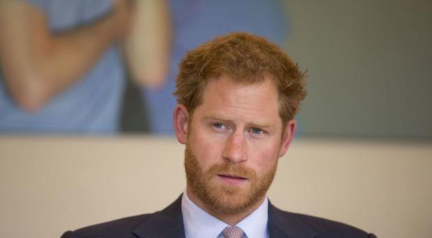 Prince Harry takes part in a round table discussion with HIV doctors at King's College Hospital
