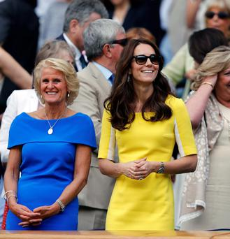 The Duchess of Cambridge looks radiant at Wimbledon with Gill Brook, wife of chairman of the All England Lawn Tennis and Croquet Club Philip Brook