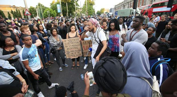 Hundreds of demonstrators protest in Windrush Square in Brixton against the killing of two black men in the United States