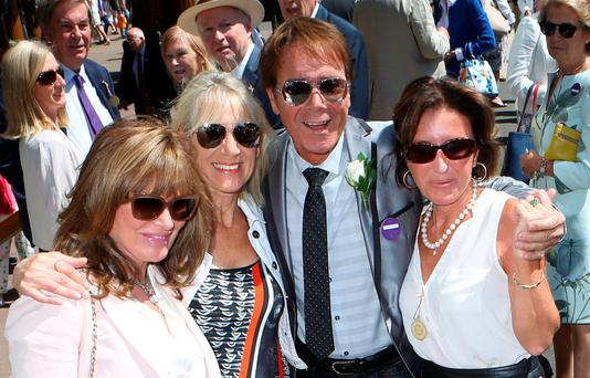 Sir Cliff Richard and guests arriving at Wimbledon to watch the tennis