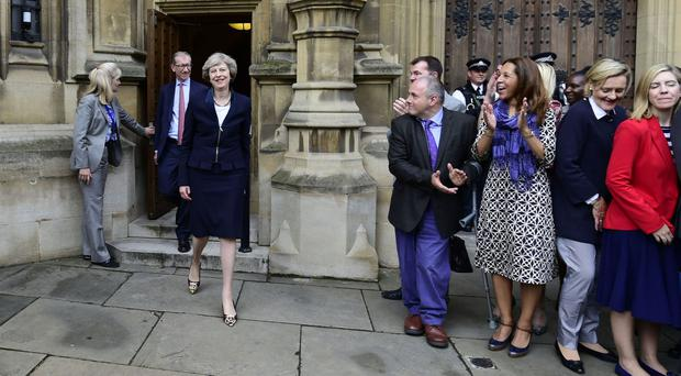 Theresa May outside the Houses of Parliament