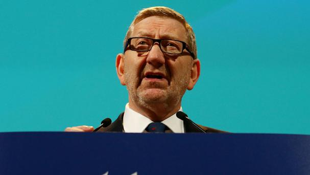 Unite general secretary Len McCluskey delivers a speech during the union's policy conference at the Brighton Centre