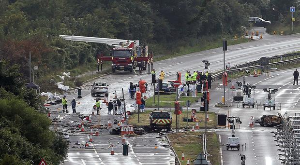 Emergency services working on the A27 after the Shoreham air disaster in which a jet crashed, killing 11 people