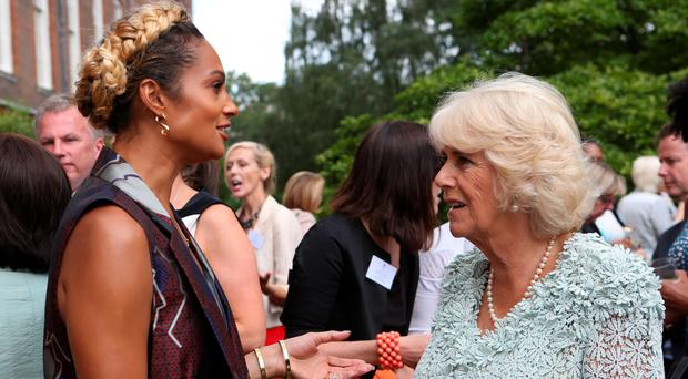 The Duchess of Cornwall speaks to singer Alesha Dixon during the reception for survivors of domestic abuse at Clarence House in London