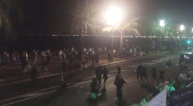 People running away after the attack in Nice (harp_detectives/PA)