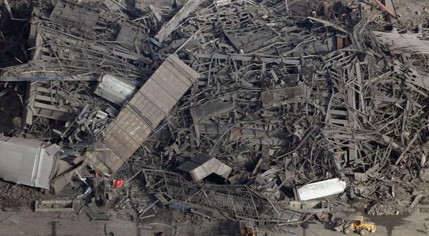 The remains of the missing men are located in the rubble