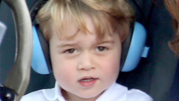 Prince George wears ear defenders in a helicopter at the Royal International Air Tattoo, RAF Fairford