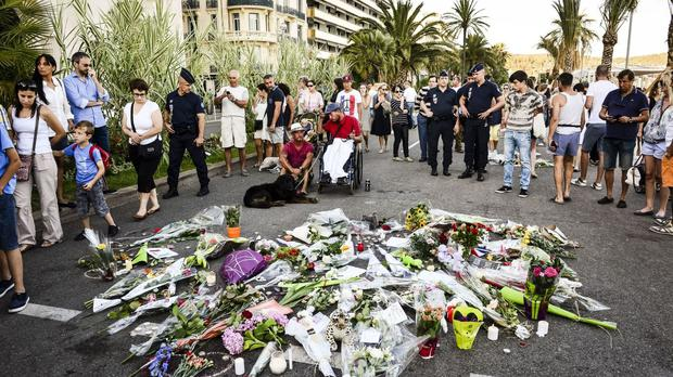 Expatriates in Nice, where at least 84 people died in the lorry massacre, said they did not intend to leave