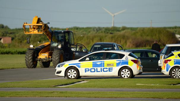 Police at the scene at Breighton Airfield where five people were seriously hurt in a helicopter crash