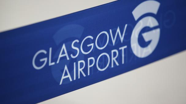 The two men were arrested at Glasgow Airport, before an Air Transat A310 was due to fly to Canada