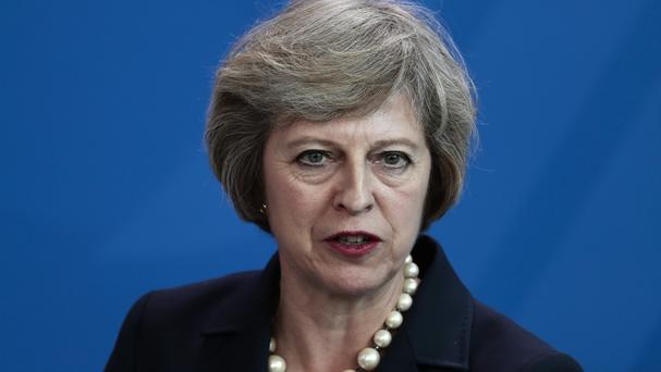 Theresa May insisted she was committed to reducing the number of people coming to the UK to