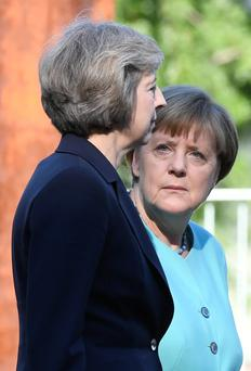 German Chancellor Angela Merkel and British Prime Minister Theresa May during a welcoming ceremony at the Chancellery in Berlin