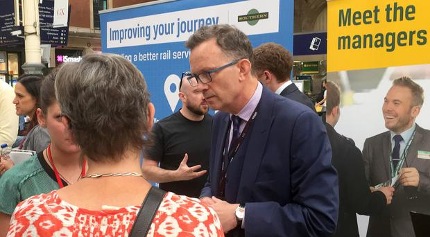 Charles Horton, CEO of Govia Thameslink, speaks to customers at Victoria Station