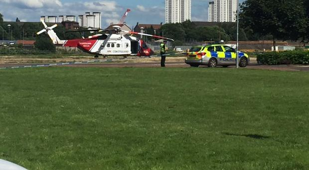 A coastguard helicopter at the scene of where a car entered the River Clyde in Renfrew (PA/Stephen Wagstaff/Twitter)
