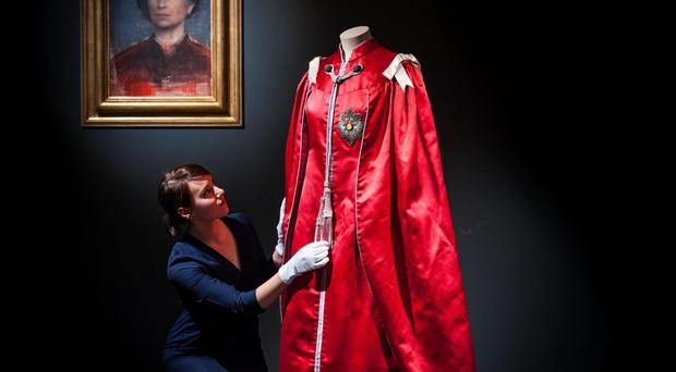 Final touches are made to the Queen's Mantle of the Order of the British Empire, worn in 1952