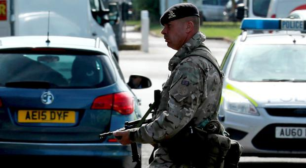 An armed guard at RAF Marham in Norfolk, after a serviceman was threatened with a knife near to base