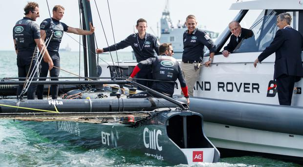 The Duke of Edinburgh has taken to the water to watch Sir Ben Ainslie prepare his bid to bring the America's Cup back to Britain for the first time in 165 years