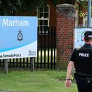 Police outside RAF Marham in Norfolk after a serviceman was threatened with a knife near to the base