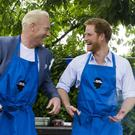 Iwan Thomas, left, and Prince Harry at the Heads Together barbecue at Kensington Palace