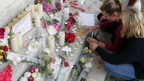 Flowers, candles and messages are placed near the home of Father Jacques Hamel in Saint-Etienne-du-Rouvray (AP)