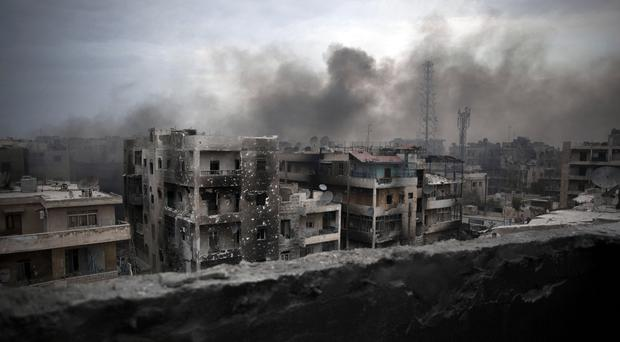Smoke rises over Aleppo, Syria (AP)