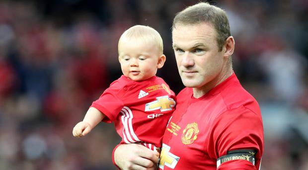 Wayne Rooney walked on to the pitch for his testimonial earlier this week with his sons