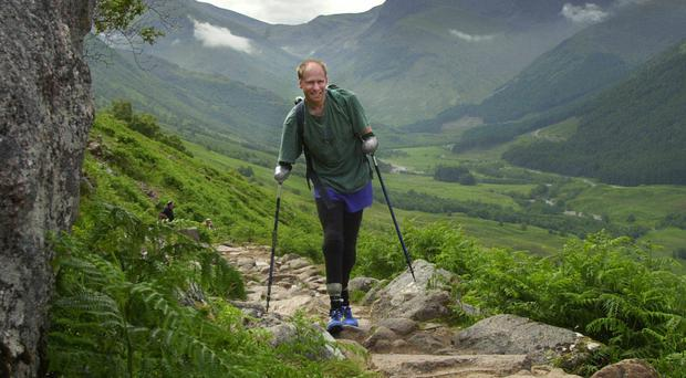 Jamie Andrew, 47, from Edinburgh, scaled the Alpine summit using prosthetic legs and specially adapted poles