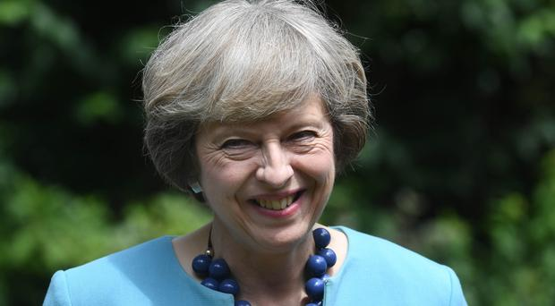 Theresa May will spend her holiday in Switzerland