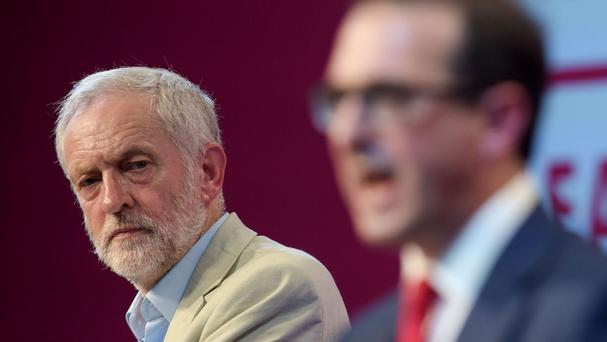The decision is an apparent boost to Jeremy Corbyn, left, in his battle to remain Labour leader against rival Owen Smith