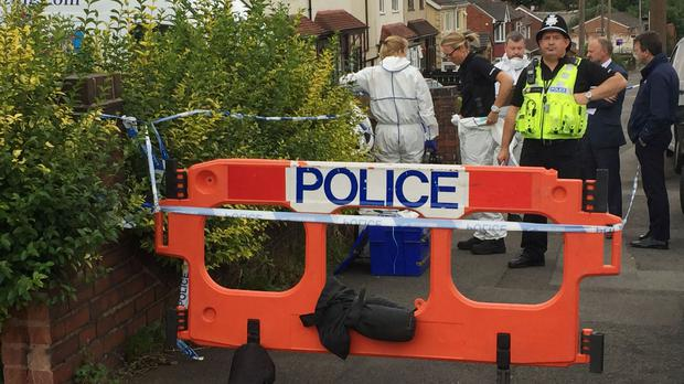 Police outside a property in Cradley Road, Netherton, Dudley, where a man was found dead