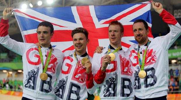 Left to right, Steven Burke, Owain Doull, Ed Clancy and Sir Bradley Wiggins with their gold medals following victory in the men's team pursuit final