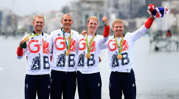 Rower Mohamed Sbihi, second left, celebrates with his team-mates after winning gold in the men's four in Rio
