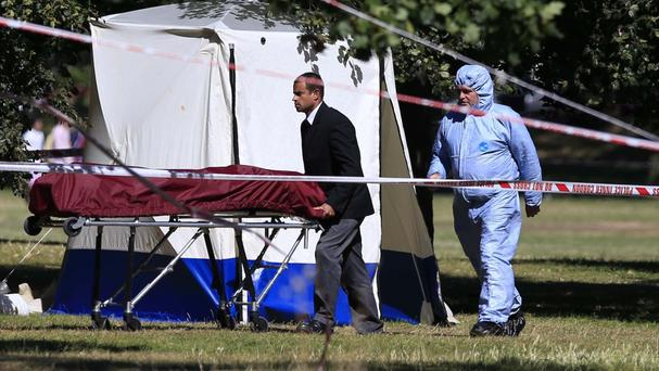 A body is removed from a police tent in Hyde Park