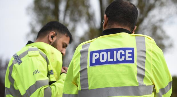 West Midlands Police dug up a grave in Birmingham after a tip-off that guns were buried in the plot
