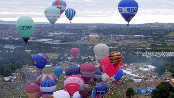 Participants take part in a mass ascent on the last day of the Bristol Balloon Fiesta at Ashton Court Estate