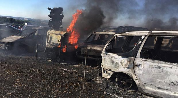 Some of the vehicles burnt out in a fire at the BoomTown Fair music festival (Hampshire Fire and Rescue Service/PA)