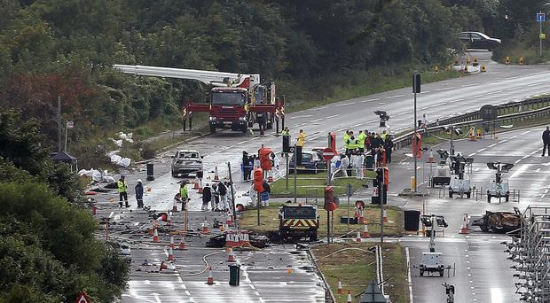 Emergency services working on the A27 in West Sussex after the Shoreham air disaster
