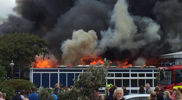 A major fire at The Academy in Selsey, near Chichester, West Sussex, where explosions have been reported (from the Twitter feed of @clarkysun/PA)
