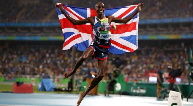 Mo Farah celebrates winning the men's 5000 metre final at the Olympic Stadium