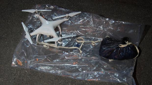 A drone with a bag, which was one of two drones carrying drugs and mobile phones seized by police after being seen flying towards HMP Pentonville in London (Metropolitan Police/PA)