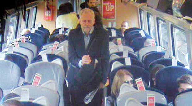 CCTV footage filmed at 11.07am, approximately eight minutes after departure from King's Cross in London, showing Labour Party leader Jeremy Corbyn walking past several empty unreserved seats in coach F