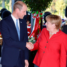 Prince William is greeted by German Chancellor Angela Merkel in Dusseldorf yesterday. Photo: John Stillwell/PA Wire