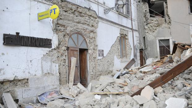 A post office is engulfed by rubble in Arcuata del Tronto, central Italy (AP)