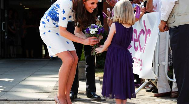Evie Farmer presents a posy to the Duchess