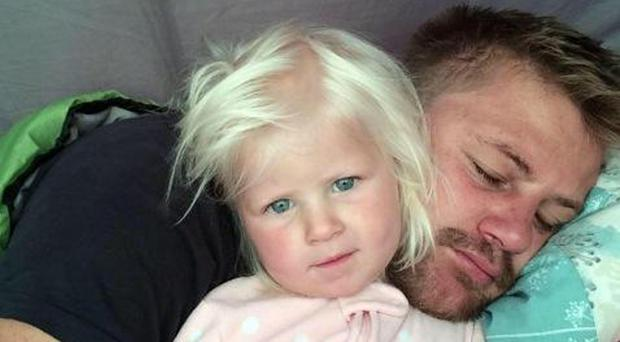Rudy Bruynius, who died after being swept out to sea at Fistral Beach in Cornwall on Saturday, with his two-year-old daughter Mckayla Bruynius (Family Handout/PA)