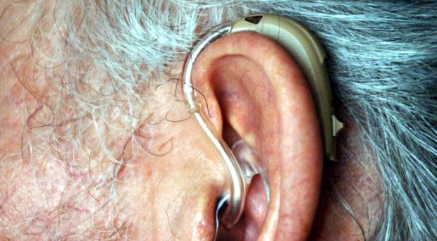 The National Deaf Children's Society warns auctioning radio frequencies could leave thousands of hearing aids and implants useless